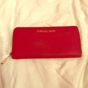 rare red michael kors sip around large wallet